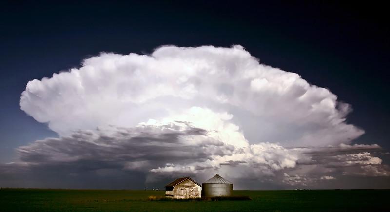 Storm clouds over Saskatchewan granaries