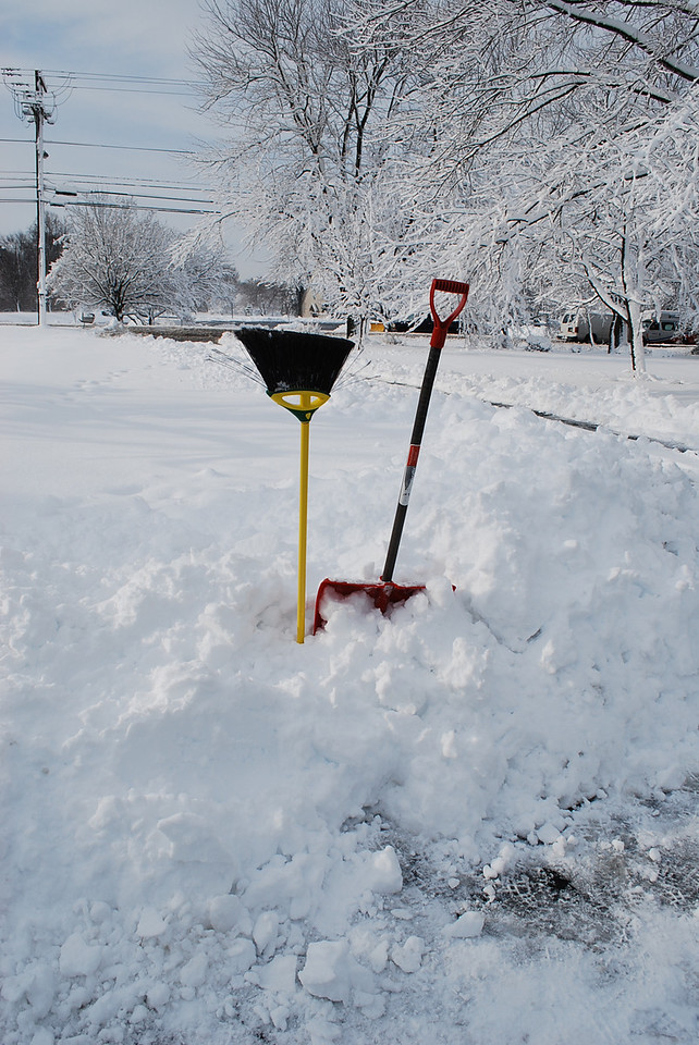 The tools we used to battle Mother Nature after our snowblowers refused to start up.