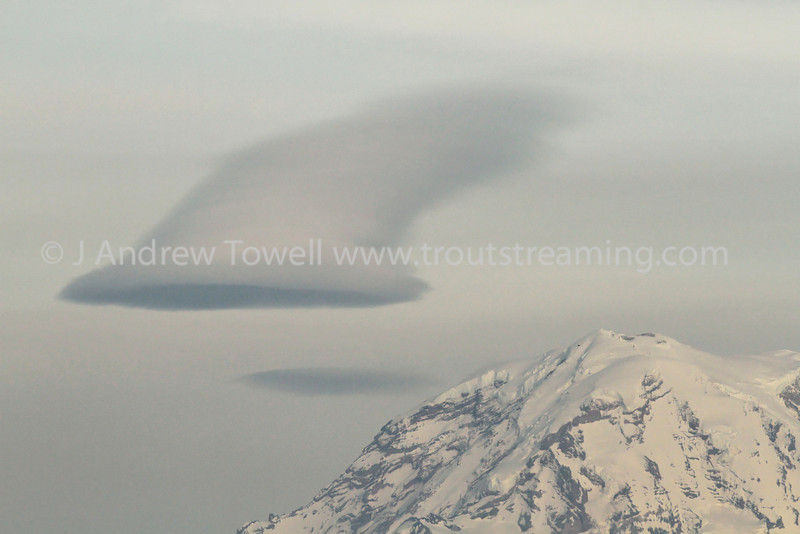 Snapshot gallery of images of a lenticular cloud formed over Mount Rainier. Images Copyright © 2012 J. Andrew Towell All Rights Reserved. Please contact the copyright holder at troutstreaming@gmail.com to discuss any publication or commercial usage rights. Small web use images available upon request with any print order.