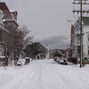 Looking east on Sir Walter Raleigh Street. Manteo Booksellers is on the left. Snowfall 2003.