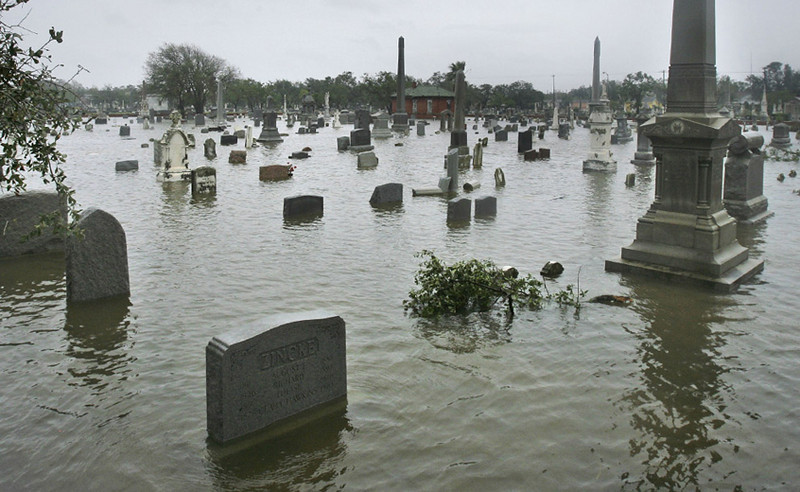 A cemetery flooded by storm surge from Hurricane Ike is shown, Saturday, Sept. 13, 2008, in Galveston, Texas. Howling ashore with 110 mph winds, Hurricane Ike ravaged the Texas coast Saturday, flooding thousands of homes and businesses, shattering windows in Houston's skyscrapers and knocking out power to millions of people. (AP Photo/Matt Slocum)