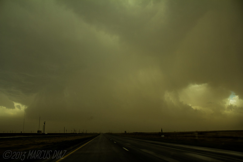 First view of the storm on HWY 60 near Black. Very ominous green tint mean this storm was dropping some big hail.