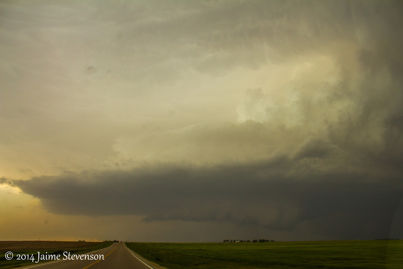 Textbook low precip supercell with a nice wall cloud developing.