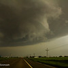 Underneath the rotating wall cloud, a small spinup in the field that last a good minute or 2.