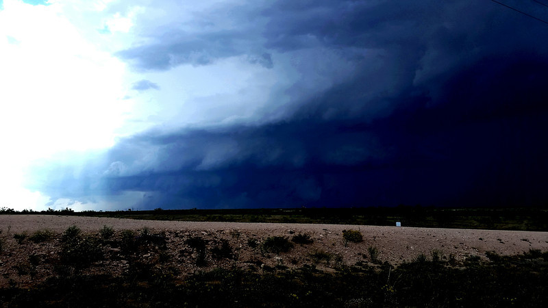 """High contrast shot, 9 minutes before the """"multi vortex"""" tornado was reported. We're only about 3 miles north of Garden City, looking northwest."""