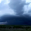Panoramic of the storm. She was lobbing softball sized hail, so we wasted no time bailing west on our only paved road.