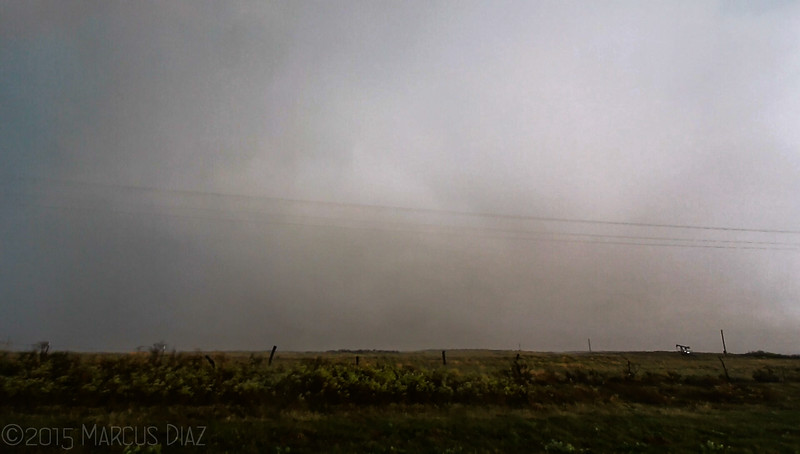 The rain and edges ofthe wall  cloud  were rapidly moving from west to east. Faint edges can be seen  here.