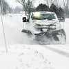 Madison County Highway Department trucks were out Monday morning clearing the snow from overnight in anticipation of more snow moving in the area later Monday afternoon and evening.
