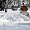 This guy, using an ATV, pushes snow along Vasbinder Drive to help widen the roadway Tuesday.