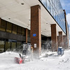 Stevan Cottrell, Madison County Government Center maintenance worker, goes about cleaning all the walkways and open areas around the courthouse Tuesday morning after a overnight snowstorm dumped about nine inches of snow causing area government agencies to close for the day.