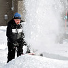 Brad Scott works his snowblower through the snow drifts along the 300 block of Washington Street as he cleans off the sidewalk along his street in Chesterfield Tuesday morning after about nine inches of snow fell over the area late Monday.