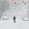 Heavy snow was falling over the area Monday afternoon through the evening making the roads snow covered and hazardous. One of the best ways to get around was by walking down the middle of the roadway like this man along East 13th Street in Anderson.