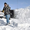 Robert Jones tosses another shovel full of snow out of the way as he digs out Tuesday morning in the 2500 block of East 5th Street after about nine inches of snow fell over the area late Monday. Jones, who used to live in Michigan, said this was just an average snow fall for him.
