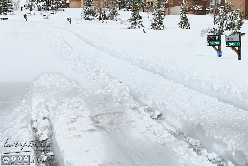 This is where I parked the Suburban while I cleared the drive.  Notice where my undercarriage was cleaned by the snow.