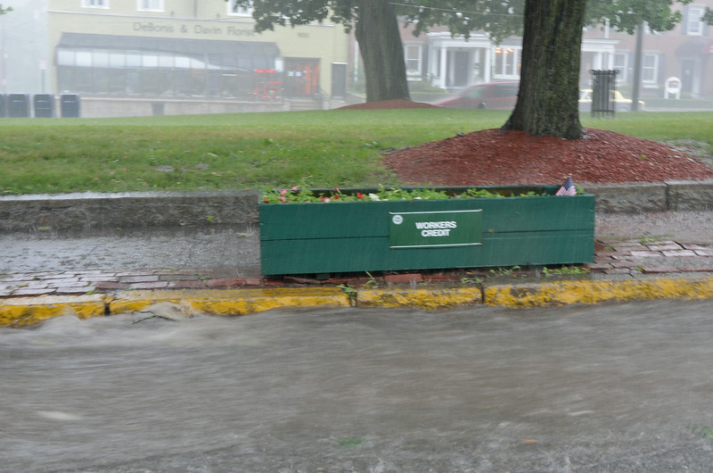 Rain floods downtown Fitchburg on Monday afternoon while flash flood and tornado warnings were issued in the area. <br /> SENTINEL & ENTERPRISE / Ashley Green