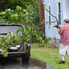 Richard Membrino removes debris from his driveway on Center Road in Ashburnham on Monday afternoon while flash flood and tornado warnings were issued in the area. <br /> SENTINEL & ENTERPRISE / Ashley Green