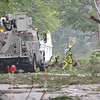 Workers clear debris hanging from wires on Corey Hill Road in Ashburnham on Monday afternoon after a storm ripped through the area.<br /> SENTINEL & ENTERPRISE / Ashley Green