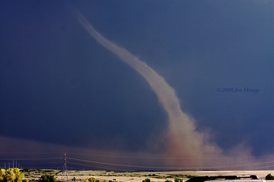 Landspout tornado still going. Image enhanced to show structure.