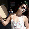 "Brenda Alderete fans herself at the Boulder Farmer's Market on Saturday.<br /> People in and around the Boulder Farmer's Market find ways to cool off during a near 100-degree day.<br /> For a video and more photos of cooling off, go to  <a href=""http://www.dailycamera.com"">http://www.dailycamera.com</a>.<br /> Cliff Grassmick / June 23, 2012"