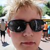 "Cooper Gottschalk develops condensation on his glasses from a fan and water spray.<br /> People in and around the Boulder Farmer's Market find ways to cool off during a near 100-degree day.<br /> For a video of cooling off, go to  <a href=""http://www.dailycamera.com"">http://www.dailycamera.com</a>.<br /> Cliff Grassmick / June 23, 2012"