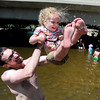 "Bill Guerrette plays in the water with his daughter, Audrey, 3, near Broadway in Boulder Creek.<br /> People in and around the Boulder Farmer's Market find ways to cool off during a near 100-degree day.<br /> For a video and more photos of cooling off, go to  <a href=""http://www.dailycamera.com"">http://www.dailycamera.com</a>.<br /> Cliff Grassmick / June 23, 2012"