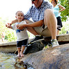 "Santiago Alexander, 2, gets introduced to the coolness of Boulder Creek by his dad, Ben, on Saturday.<br /> People in and around the Boulder Farmer's Market find ways to cool off during a near 100-degree day.<br /> For a video of cooling off, go to  <a href=""http://www.dailycamera.com"">http://www.dailycamera.com</a>.<br /> Cliff Grassmick / June 23, 2012"