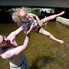 "Bill Guerrette plays in the water with his daughter, Audrey, 3, near Broadway in Boulder Creek.<br /> People in and around the Boulder Farmer's Market find ways to cool off during a near 100-degree day.<br /> For a video of cooling off, go to  <a href=""http://www.dailycamera.com"">http://www.dailycamera.com</a>.<br /> Cliff Grassmick / June 23, 2012"