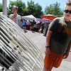 "Cooper Gottschalk cools off in front of a fan with water spray.<br /> People in and around the Boulder Farmer's Market find ways to cool off during a near 100-degree day.<br /> For a video of cooling off, go to  <a href=""http://www.dailycamera.com"">http://www.dailycamera.com</a>.<br /> Cliff Grassmick / June 23, 2012"