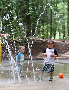 Places to cool off: Manning State Forest in Billerica has walking trails and a Water Playground. Brayden McCarthy, 1, of Chelmsford, left, and Colton DePietro, 3, of Billerica. (SUN/Julia Malakie)
