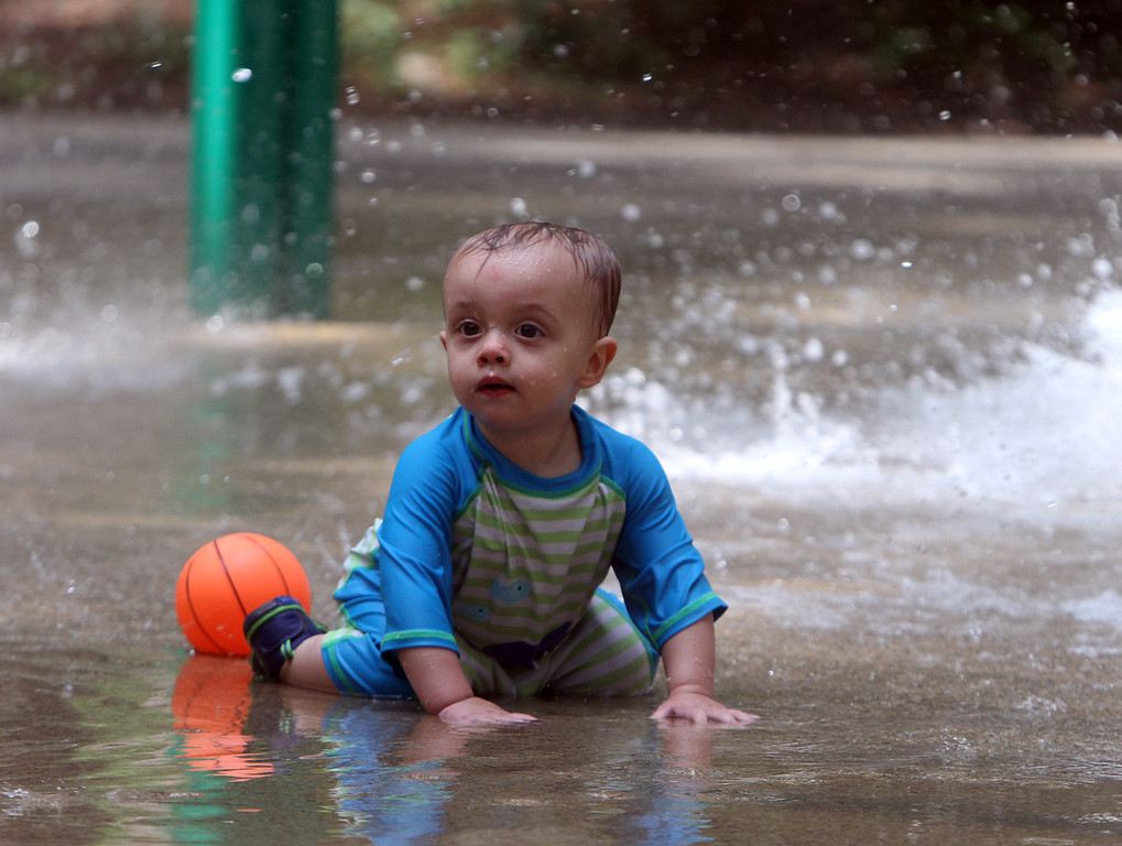 . Places to cool off: Manning State Forest in Billerica has walking trails and a Water Playground. Brayden McCarthy, 1, of Chelmsford, stays cool in the Water Playground. (SUN/Julia Malakie)