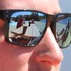 Lifeguard Tom Wiggins of Billerica and fellow lifeguards wait for beachgoers at an empty Micozzi Beach in Billerica. (SUN/Julia Malakie)