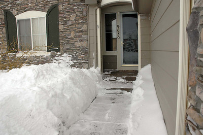 The entry is on the north side, so this snow will take forever to melt. Also drifted, all the way to the front door.