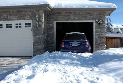 The MINI is hemmed in by the snow pile. Too much work to clear snow in front of the queen's door.