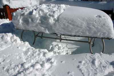 Not going to use the patio table anytime soon. The snow on top is new, as the first snowstorm snow had already melted off the top. The snow around the bottom of the table is composed of storm #1 and #2, plus some drifting.