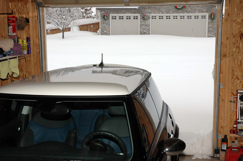 The MINI is nice and snug inside, with over 2 feet of snow outside. Without any landmarks, the snow in the street seems to be about six feet deep! It's only an illusion and about 2 feet deep, drifting to 3 to 3 1/2 feet in some places.