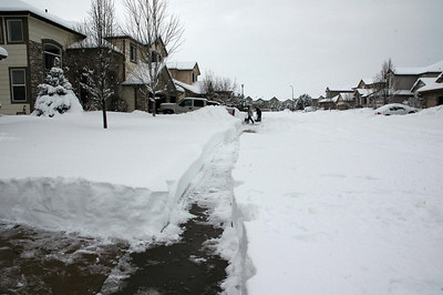 Sidewalk cleared by the neighbor with his large snow thrower. Thanks!