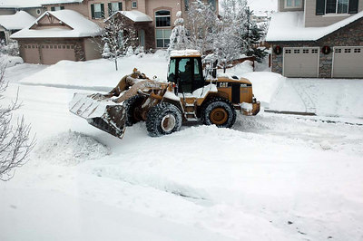 The city's front-end loader makes big piles wherever there is room on the street. This is to the left of our house.