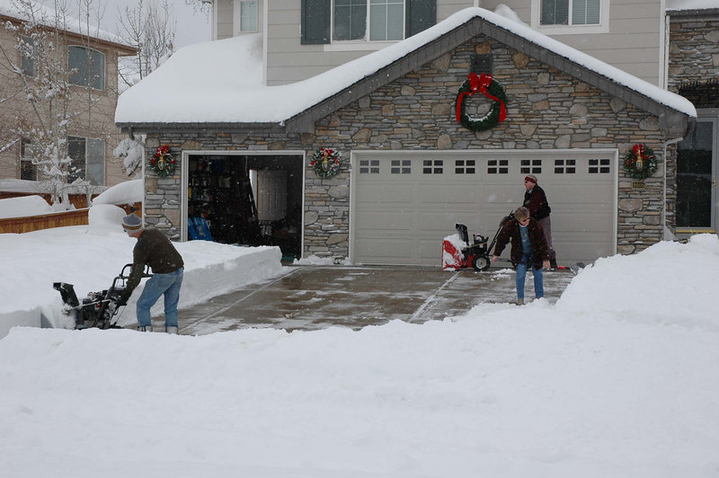 Neighbors making quick work out of 2+ feet of snow with their machines.