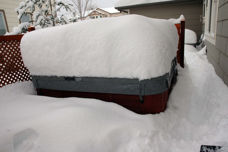 This snow was insulating the hot tub, helping keep the water hot. Can't wait to get into the 104 degree water!