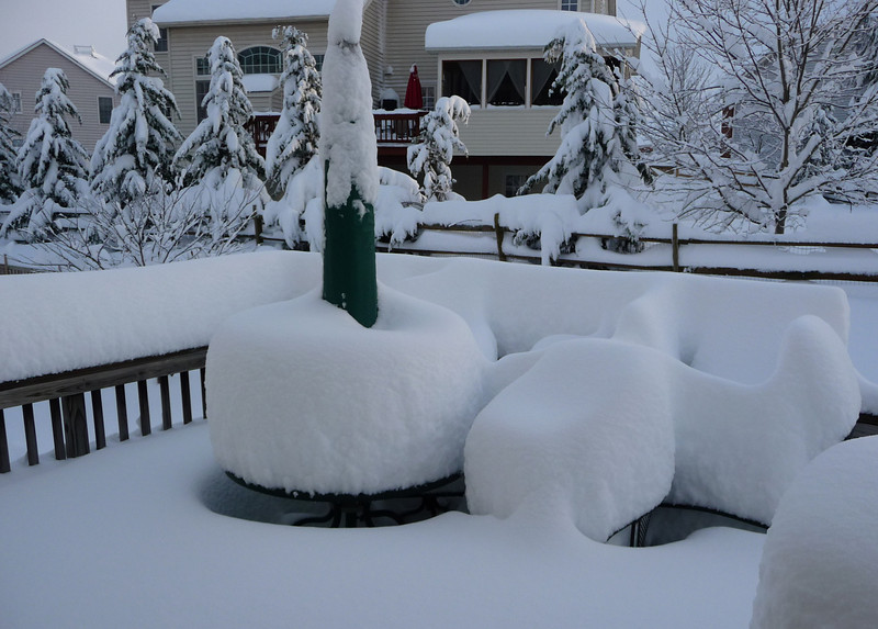Table, chairs on our deck. Also the back of our rear-facing neighbor's house.