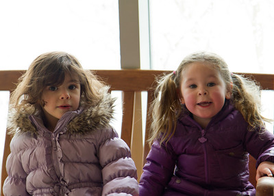 Lila and her friend, Victoria, taking a brief break from playing in the snow.