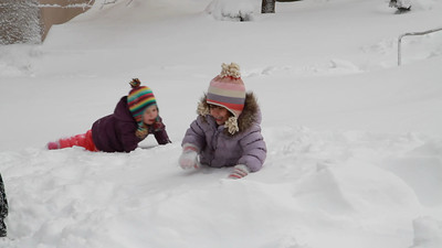 Lila and her friend, Victoria, playing in the snow.