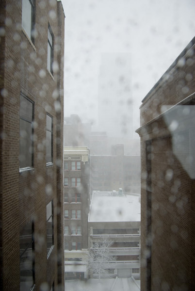 You can just make out the tall building only two blocks away.  This photo was taken through a window.