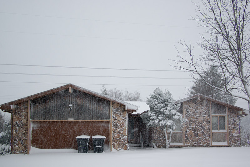 You can see the snow against the dark garage door.