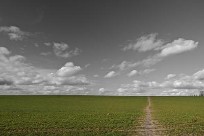 Rural landscape with clouds partial colour