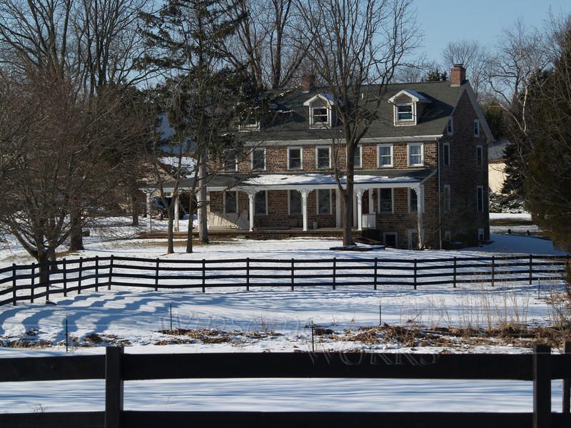 Fieldstone farmhouse on Snowy Day - Springfield Township, PA