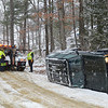 A truck arrives from Aldrich Auto Body & Repair to tow a Jeep that turned over on its side as road conditions became slippery due to falling snow on Monday. Nobody was injured in the accident<br /> SENTINEL & ENTERPRISE / BRETT CRAWFORD