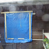 This is the first rain squall - the last 'before' picture I took (actually the first and only 'during' picture) - the leaky door into bedroom is tarped to keep out the rain.