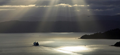 Bluebridge ferry and plane over Wellington Harbour - 9 March 2012.