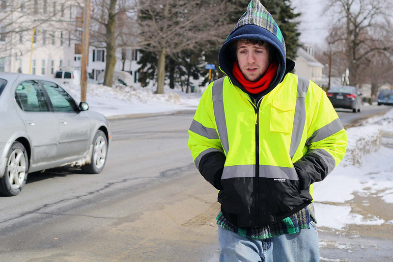 Zak Vincent, 22, was all bundled  up for the cold on Thursday afternoon as he was caught walking down West Street in Leominster on his was to his home in Fitchburg. SENTINEL & ENTERPRISE/JOHN LOVE